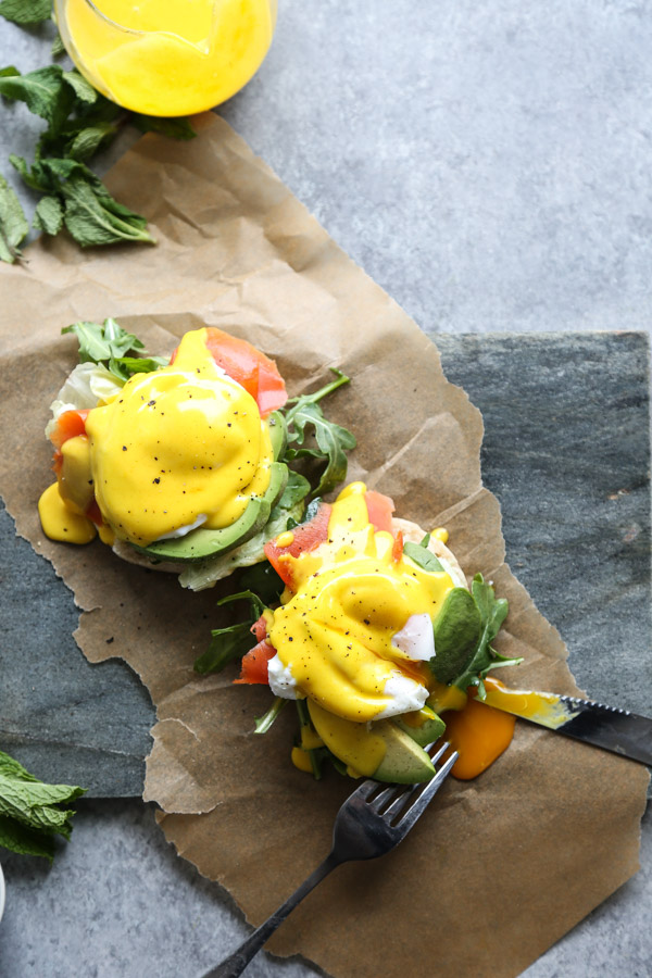 Paleo Eggs Benedict with Smoked Salmon, Garlicky Greens and Turmeric-Ghee Hollandaise